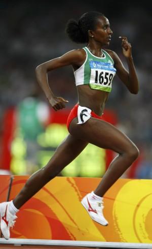 Tirunesh Dibaba of Ethiopia runs on way to winning women's 5000m final at Beijing 2008 Olympic Games